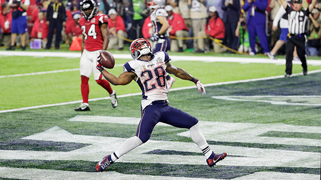 HOUSTON, TX - FEBRUARY 05:  James White #28 of the New England Patriots celebrates rushing for a 1-yard touchdown in the fourth quarter against the Atlanta Falcons during Super Bowl 51 at NRG Stadium on February 5, 2017 in Houston, Texas.  (Photo by Jamie Squire/Getty Images)