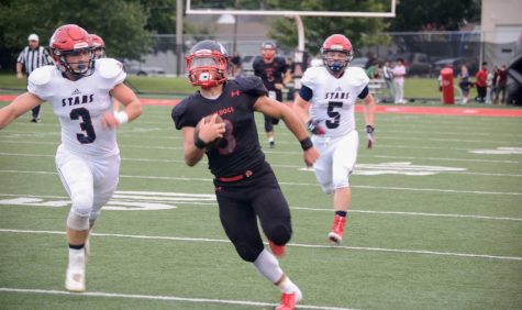Football team beats Providence in season opener, 35-12