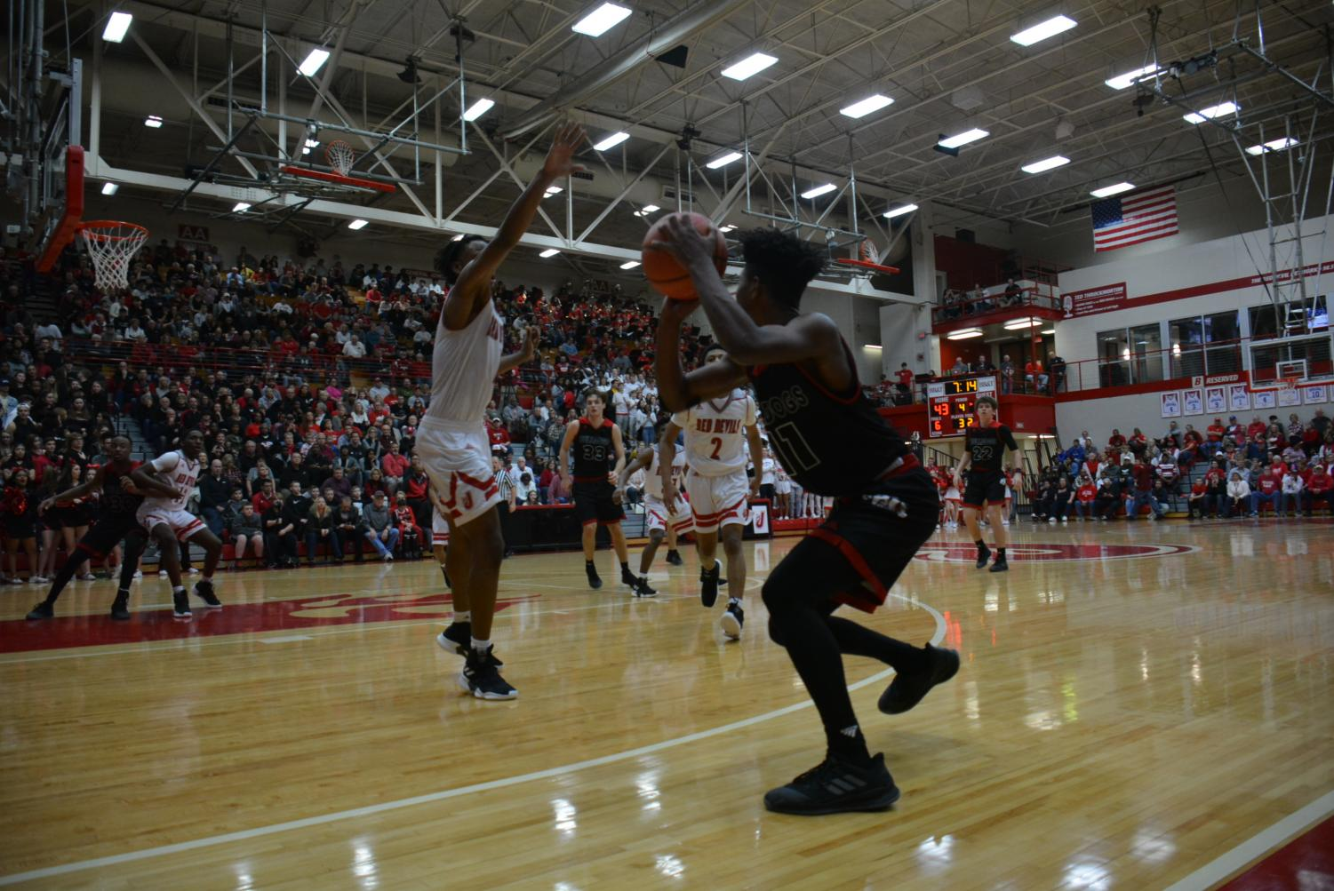 Senior Derrick Stevenson fakes out the defender.