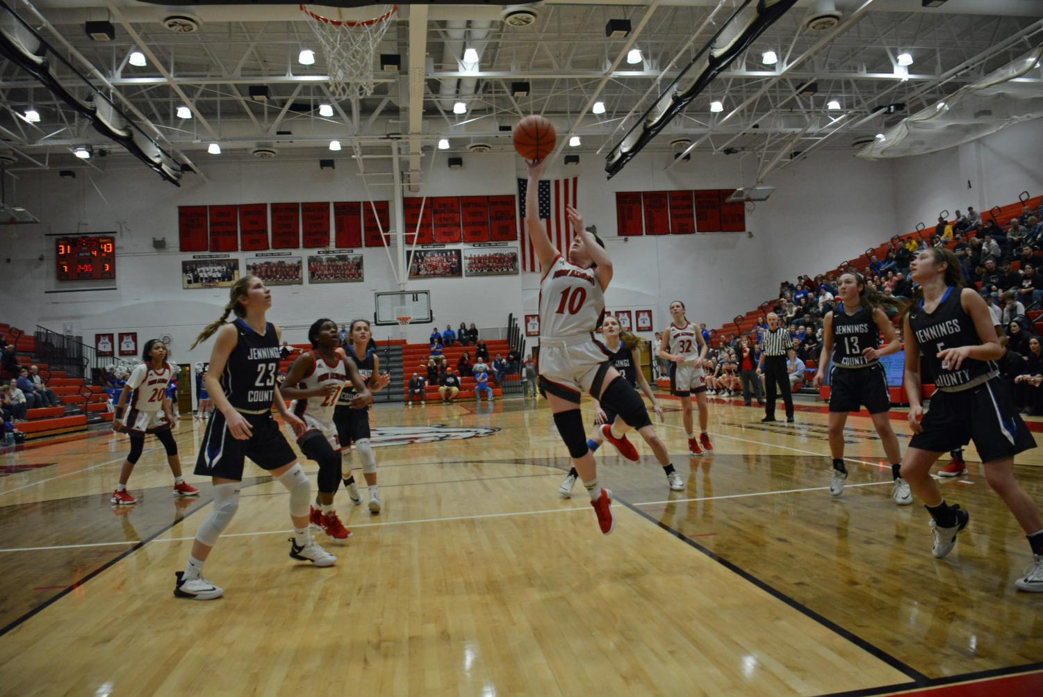 Senior Ally Willis drives the baseline for a layup.