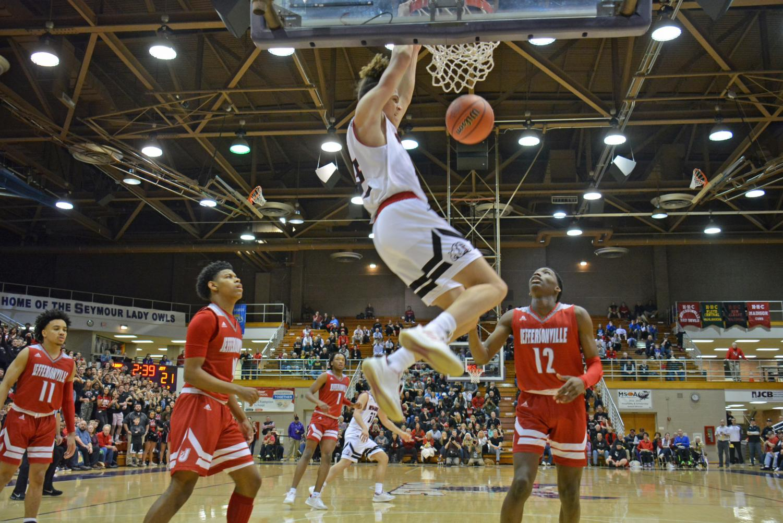 Jordan Thomas dunks the ball sending the arena into a frenzy.