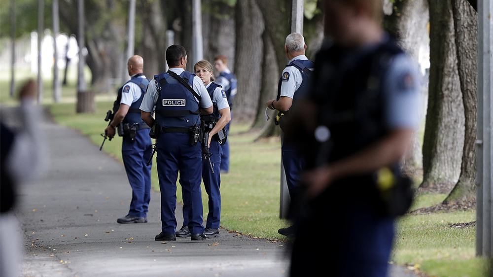 Police across the street from the mosques attacked in New Zealand shortly after the attack. (AP Photo/Mark Baker)